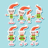 Vector Illustration of the playful Santa elves Stock Photography