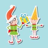 Vector Illustration of the playful Santa elves Stock Images
