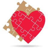 Puzzle pieces heart on white background Stock Photo