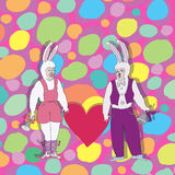 Vector illustration of a rabbit heart. The composition of the two actors dressed as hares on the background of motley decoration Royalty Free Stock Photography