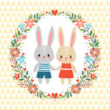 Vector illustration of rabbits in the floral frame. Royalty Free Stock Photos