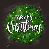 Vector illustration of realistic christmas fir wreath on top view with hand lettering christmas greetings label on chalkboard.  Stock Image