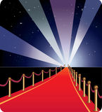 Vector illustration of red carpet. Red carpet going into the distance. The starry arch and the spotlights rays Royalty Free Stock Image