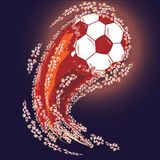 Red soccer ball with shining splash tail, vector illustration. Vector illustration with red soccer ball with shining splash tail, dark blue backgroud Royalty Free Stock Image