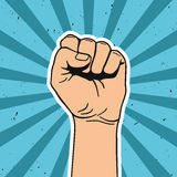 Vector illustration in retro style of clenched fist held high in protest. Comics art Royalty Free Stock Photo