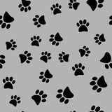 Vector illustration of a seamless pattern of black wild animal paws on a gray background Royalty Free Stock Photography