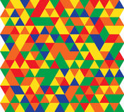 Vector illustration of a seamless pattern of simple triangles of red, green, blue, yellow and orange.  Royalty Free Illustration