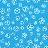 Seamless pattern. White snowflakes on a blue backgrounds. For packaging paper. Vector illustration. Seamless pattern. White snowflakes on a blue background. For Stock Illustration