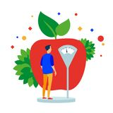 Man measures the weight before the apple. royalty free illustration