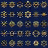 Vector illustration set of hand drawn golden snowflakes as Chris. Tmas holiday decorating elements isolated on dark blue background Stock Image
