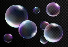 Vector illustration set of realistic bright soap bubbles with rainbow colors on transparent black background. vector illustration