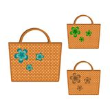 Set of three wicker bags decorated with multicolored flowers. Isolated on white background. For fashionable woman. Beautiful gift. Vector illustration of set of Royalty Free Stock Photos