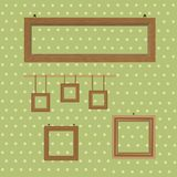 Set of wooden decorated frames hanging on the background of wallpaper in polka dots. Vector illustration of set of wooden decorated frames hanging on the Royalty Free Stock Photo