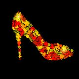 Vector illustration of shoes from autumn leaves Royalty Free Stock Image
