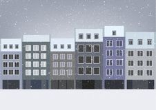 Vector illustration of six houses in a row in a winter scenery Stock Image
