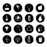 Vector illustration of sixteen black and white grunge icons illustrating the concept of a green environmentally friendly city.  Royalty Free Stock Image