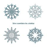 Vector illustration of snowflakes with silver glittering texture.  Royalty Free Stock Images