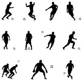Vector illustration of soccer players silhouettes. The Vector illustration of soccer players silhouettes Royalty Free Stock Images