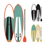 Vector illustration of stand up paddle boards. In flat design style Stock Images