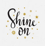 Vector illustration. Star background with  stylish lettering - `Shine on`. Stock Images