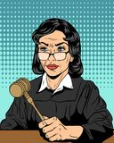 Strict judge with a hammer Royalty Free Stock Photos