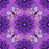 Vector illustration texture. Beautiful floral oriental seamless pattern made of many mandalas and butterflies. Background in violet colors. Vector illustration Royalty Free Stock Image