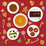 Holiday dinner table. Vector illustration of traditional Christmas desserts in flat style isolated on red background. Holiday food on a table view from above Stock Images