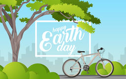Vector illustration of a tree with text happy earth day. Green trees with large crowns and a bike. You can use, websites Royalty Free Stock Photo