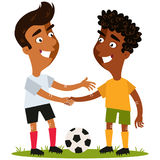 Vector illustration of two friendly cartoon soccer players standing on football field with the ball shaking hands with respect Stock Photography