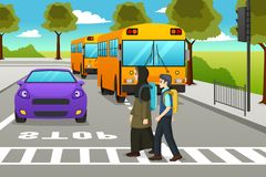 Two Students Crossing the Street to Go to School stock images