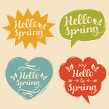 Vector illustration typography Say Hello To Spring set in speech bubbles. Inspirational hand lettering background. Vector illustration typography Say Hello To Royalty Free Stock Photo