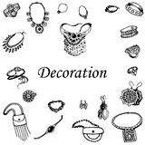 Vector illustration of a variety of decorations. Doodle bijouterie. Jewelry hand-drawn. On an  white background Royalty Free Stock Photo