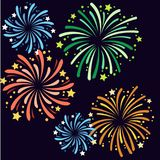 Vector illustration of various fireworks on New Year`s Eve. Red, green, yellow and blue fireworks in the night sky Royalty Free Stock Photo