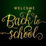 Vector illustration of welcome back to school greeting card with gold glitter lettering element on dark background Stock Image