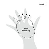 Vector Illustration of World Wildlife Day with Animal Footprint. Black and White Vector Illustration of World Wildlife Day with Animal Footprint and Human Hand Royalty Free Stock Photography