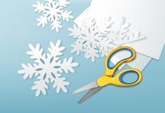 Scissors and paper snowflakes Stock Photo
