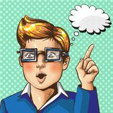 Vector vintage pop art illustration of boy gesturing. Vector illustration of young boy in glasses with forefinger up gesture, hand sign, thought bubble in retro Stock Photography