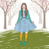 Vector illustration of a young girl standing. In a blooming garden Royalty Free Stock Photography