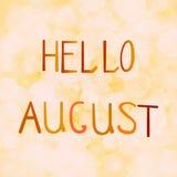 Vector Illustrationsaufschrift hallo August auf einem orange Hintergrund bokeh Stockbild
