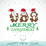 Vector image of an christmas greeting card. Monkeys and santa hat. Merry Christmas lettering Royalty Free Stock Photos