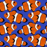 Clown Fish Seamless Illustration Vector Blue Background. Vector image of Clown fish pattern on blue background.  Image is seamless design for wallpaper Stock Photo