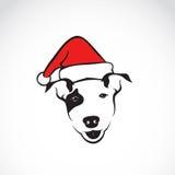 Vector image of an dog and santa hats Stock Photos