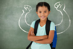 Composite image of  image of hand flexing muscles. Vector image of hand flexing muscles against portrait of cute school girl standing with arms crossed Stock Images