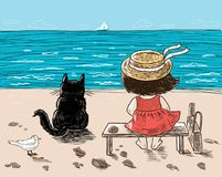 A little girl and her cat are sitting on the seashore Royalty Free Stock Images
