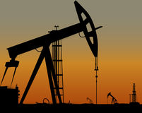 Vector image of oil derricks on the ground Royalty Free Stock Images
