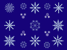 Picture of different snowflakes on blue background. Winter decor with a picture of snowflakes in the night sky Royalty Free Illustration