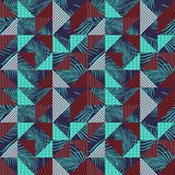 Vector inconsútil del modelo con las hojas de palma coloridas y el triángulo geométrico imagenes de archivo