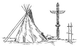 Indian teepee and totem Stock Photography