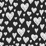 Vector ink pen background with hearts. Grunge seamless hand drawn pattern on black background Royalty Free Stock Photo