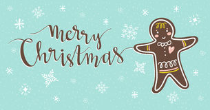 Vector isolated illustration with gingerbread man on the blue background and Christmas lettering. Stock Images